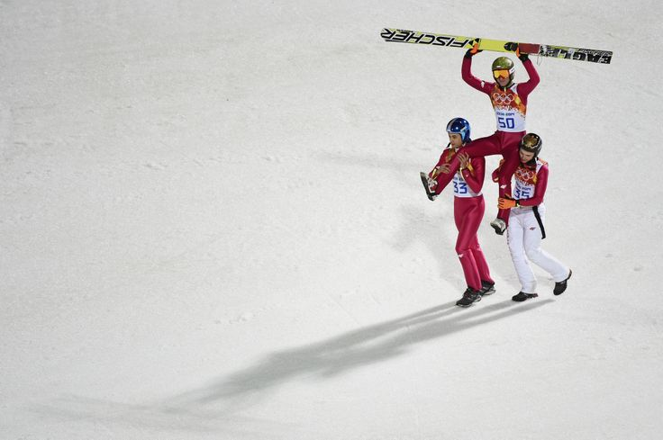 Gold medlaist Kamil Stoch of Poland is lifted on the shoulders of Maciej Kot of Poland and Jan Ziobro of Poland after the Men's Large Hill Individual Final Round (c) Getty Images