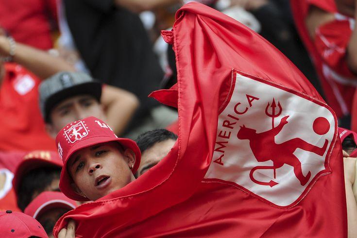 Fiesta roja en El Campín: así vivieron los hinchas el triunfo de América de #Cali