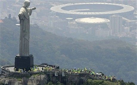 Christ the Redeemer looking over Rio de Janiero and a World Cup 2014 stadium. #Football