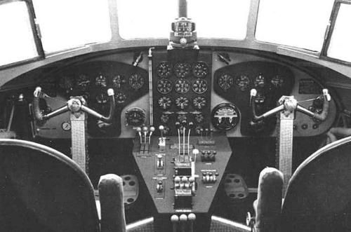 "Old-time cockpit- ""Instruments panel and flight controls inside the cockpit of an Italian three-engine transport plane Savoia-Marchetti SM.82 ""Marsupiale"" (Marsupial). Clearly visible control wheels, rudder pedals, hand throttles, compass, instruments ""clock-type"" and many other devices in good part today disappeared. An old-time flying perhaps ""romantic"", but extremely demanding for the pilot…"" -Victor Sierra"