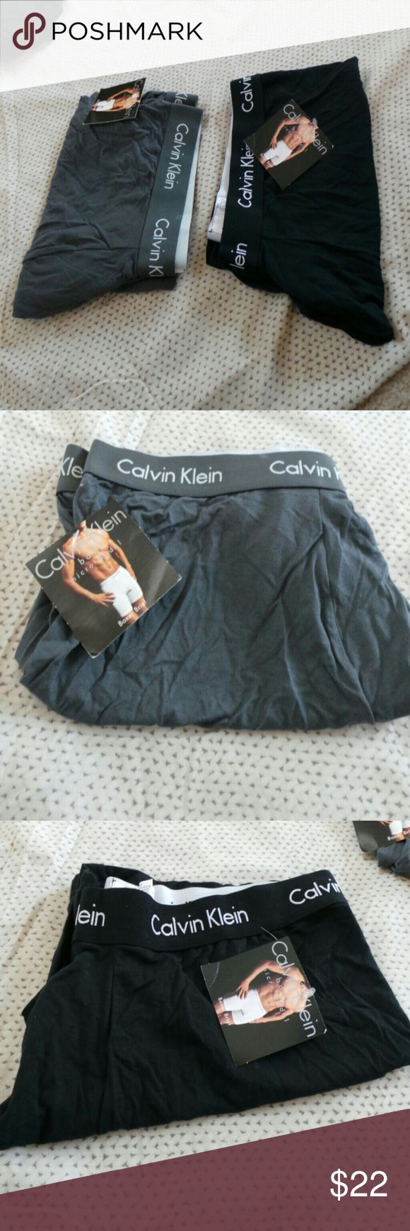 Calvin klein men's boxer briefs NWT men's boxer briefs.black one had three small stains as shown in pic. 2 for one price. Calvin Klein Underwear & Socks Boxer Briefs