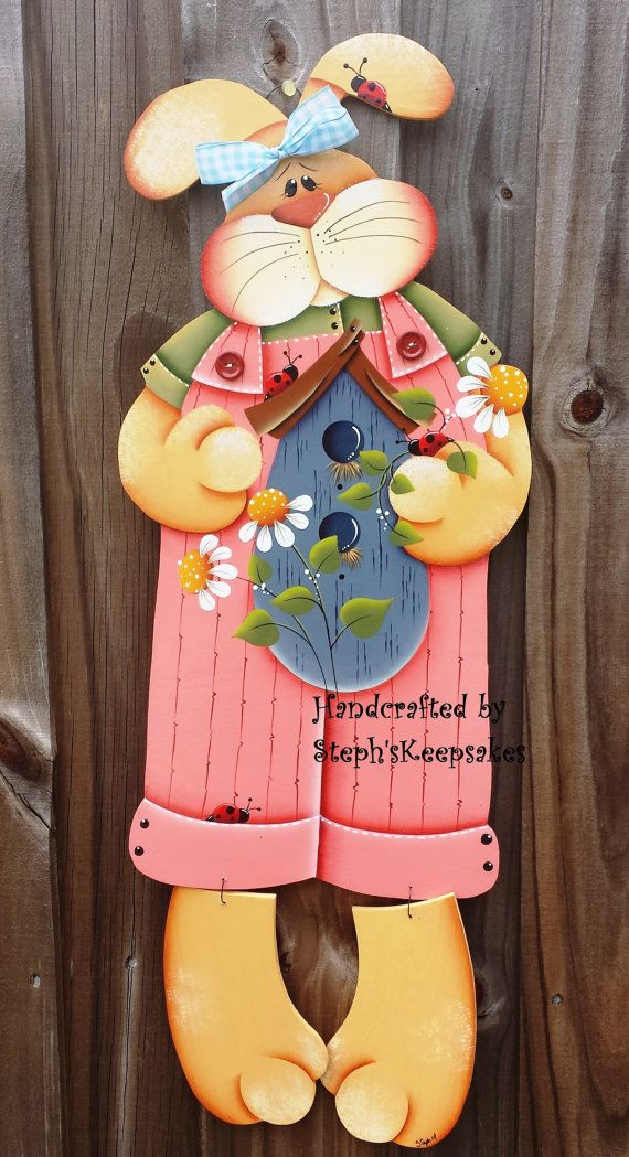 https://www.etsy.com/pt/listing/127217343/hand-painted-spring-bunny-hanger-wooden?ref=related-1