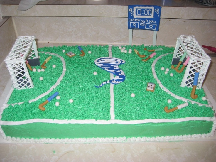 Hockey sticks, balls, cyclone and tiny clipboards are made of  fondant and gumpaste. The goalie cages are made of a fondant gumpaste blend with the nets made out of royal icing. The field was made of buttercream with a 233 tip for the grass. Hope you like it. I had a blast making it