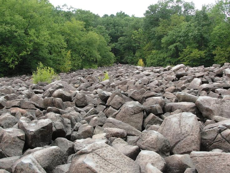 """Ringing Rocks County Park, Upper Black Eddy, Langhorne, Bucks County, Pennsylvania - photo by GardeningMom42, via TripAdvisor;  """"Rocks, piled 10-feet high, ... ring like bells when struck lightly with a hammer"""" ... and scientists don't know exactly why.  The rocks have a high content of iron and aluminum, and while """"all the rocks are made of the same material, ... only a third ring when struck.""""  -  info from VisitPhilly"""
