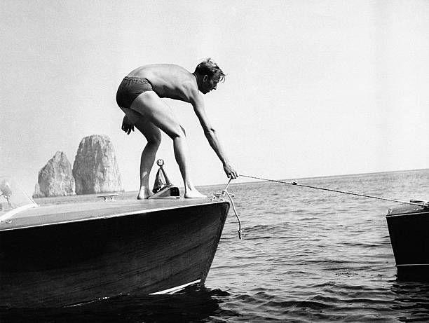 Moritz of Hesse Prince and Landgrave of HesseKassel untying his boat from the pier Capri September 1954