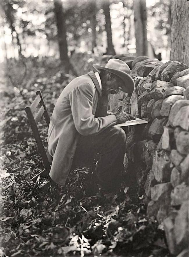 The picture was taken at the Stone Wall at Gettysburg. Picture shows the old soldier writing his memories of the Battle of Gettysburg, at the Gettysburg Reunion. It was created in 1913 by Harris & Ewing.