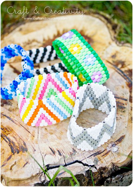 Bracelets made with perler beads! Why have I never thought of this?? Exactly like the bracelets I make, but with huge beads and elastic thread. A stop at the craft store is in order ... then the rest of the evening will be spend sorting beads.