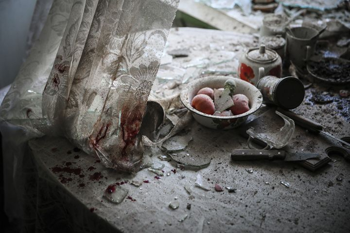 The 1st prize in the General News Single category of the 2015 World Press Photo Contest by Sergei Ilnitsky, Russia, for European Pressphoto Agency, shows a kitchen table after a mortar attack in downtown Donetsk, Ukraine. (AP Photo/Sergei Ilnitsky, European Pressphoto Agency)