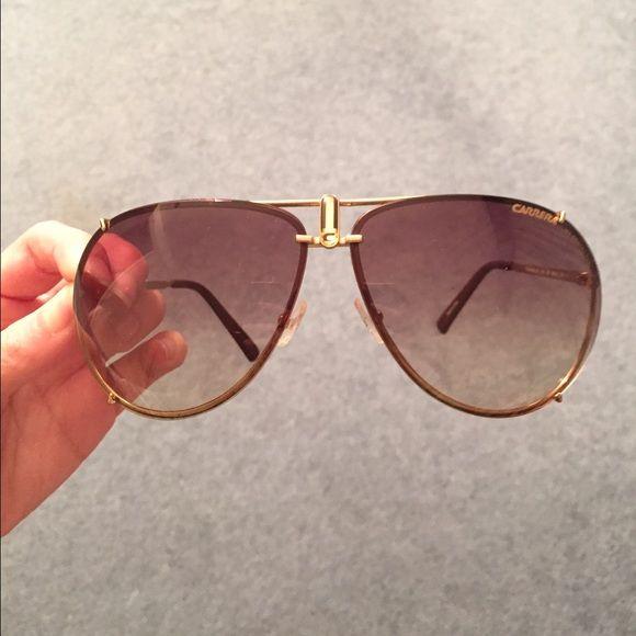 Brand new Carrera sunglasses Brand new, never worn Carrera sunglasses. Perfect condition, no scratches or any sign of wear. Classic gold aviator style! Carrera Accessories Sunglasses