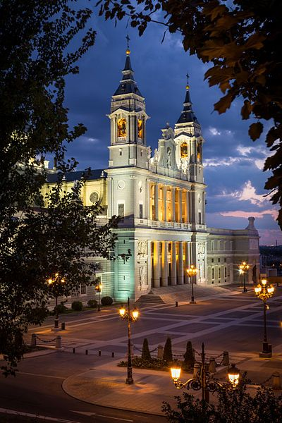 Facade of the Almudena Cathedral at dusk, Madrid, Spain
