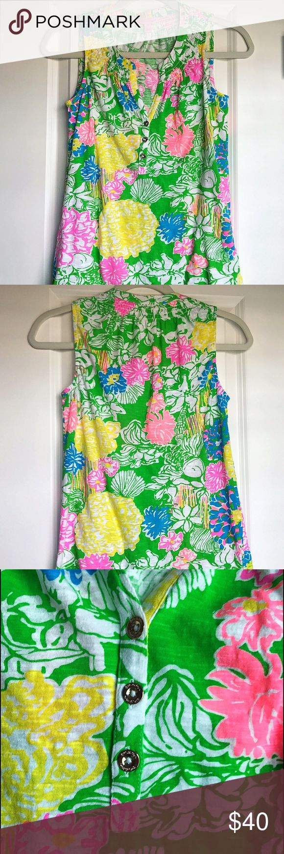 Lilly Pulitzer Multi Hibiscus Print Essie Top, XS Lilly Pulitzer Multi Hibiscus Print Essie Top, Size XS. EUC, only worn twice. No stains or tears. Gold button detail. Cotton Jersey, smocking around neckline. Bright, beautiful top for spring! 🌺 Lilly Pulitzer Tops Tank Tops