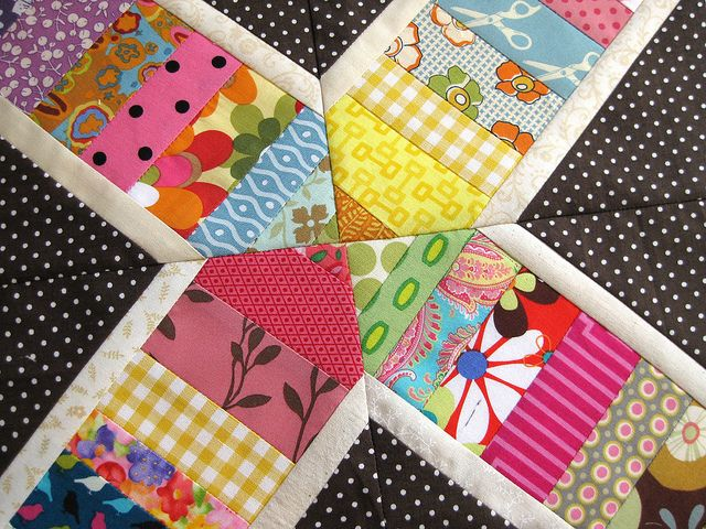 April Block by ellis & higgs. I like the black polka dot with the fun, bright strings.