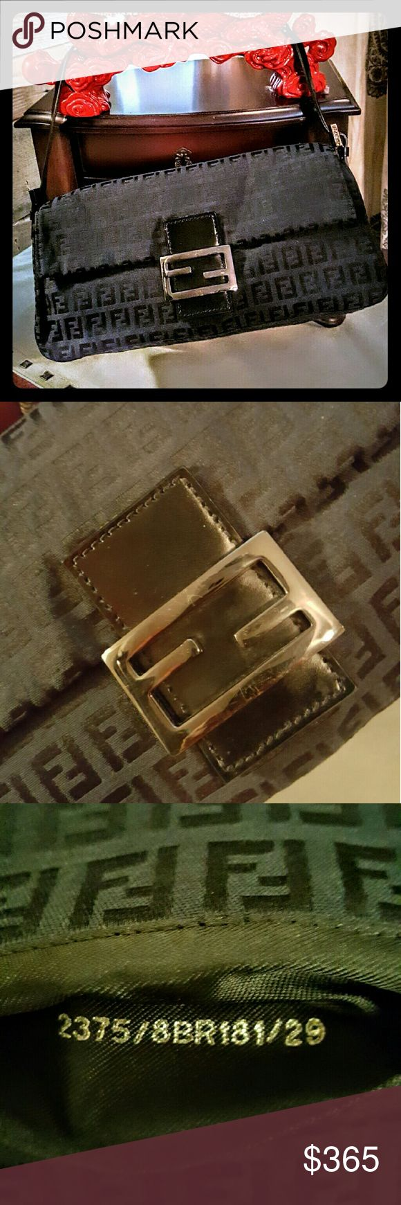 """FENDI ZUCCA BAGUETTE CLUTCH 100% AUTHENTIC FENDI BAG CLASSIC BLACK SILVER/BLACK HARD WARE SIZE 11.5"""" LONG X 5.5"""" TALL X 3.5"""" DEEP INSIDE SMALL OPEN POCKET MAGNETIC CLOSURE MINOR SCRATCHES ON FRONT CLASP GENTLY USED OVERALL EXCELLENT CONDITION! MEDIUM MINI ZUCCA BAGUETTE CLUTCH SMOOTH GRAIN LEATHER STRAP FENDI ZUCCA PRINT THROUGHOUT ADJUSTABLE THIN STRAP NEVER GOES OUT OF STYLE! SERIOUS BUYERS ONLY *NO TRADES NO RETURNS PLEASE ASK QUESTIONS* Fendi Bags Clutches & Wristlets"""