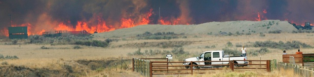 Anxious residents keep an eye on a wildfire that burns out of control near Camp Williams and Eagle Mountain on Aug. 6. (Steve Griffin   The Salt Lake Tribune)