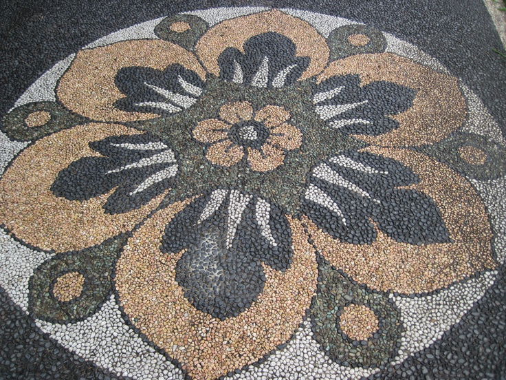 Pebble flower mosaic for a garden path....