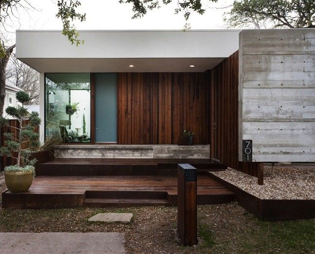 The house shows a modern but private face in a dense neighborhood.