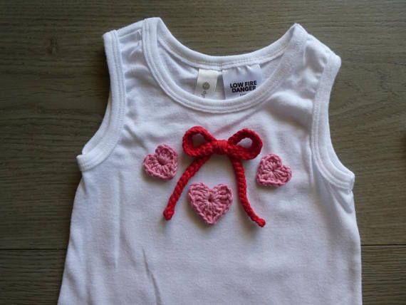 Baby girl onesie / bodysuit with crochet embellishment