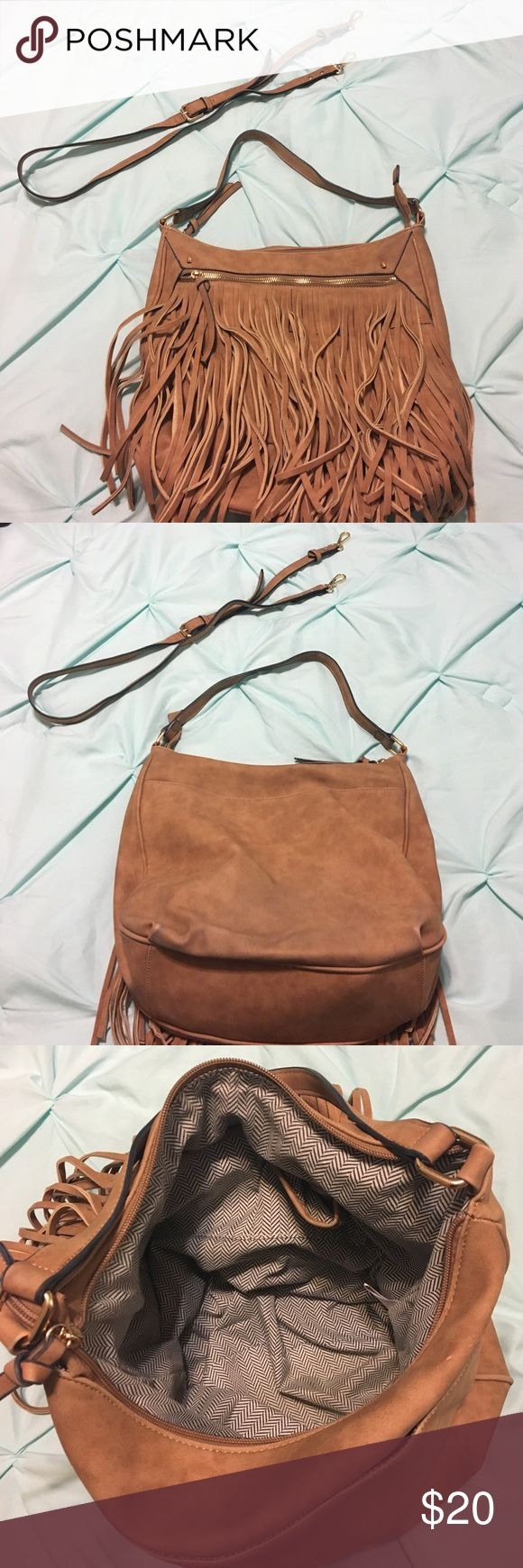 "Large camel color fringe hobo handbag. Large camel color fringe hobo handbag. Outside zipper pocket. One open pocket on the other side. Inner side pocket. Pockets to hold cell phone and keys. 13"" length. 4"" width. 12"" depth. Cross body strap comes with it, adjustable as well. Has no brand name, I looked everywhere on this thing! Negotiable. Bags Hobos"