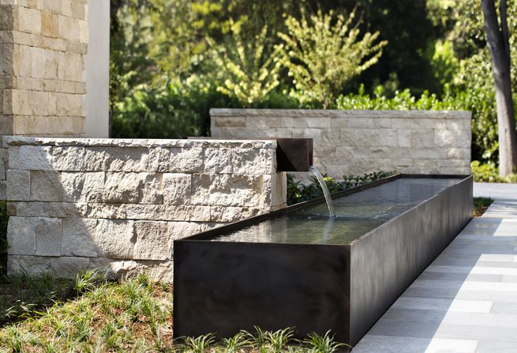 Trough fountain - the sound of water in a garden, especially in a hot climate, is even more important than the look of it.