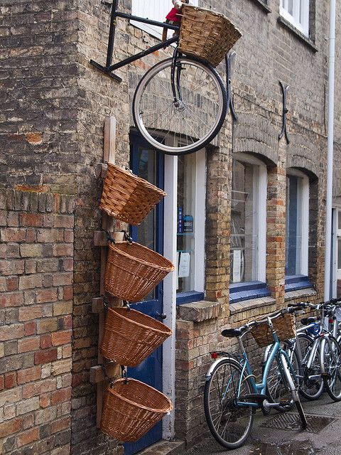 Bicycle basket store (*i wish to ride a bicycle on the streets of a foreign country ... italy maybe!)
