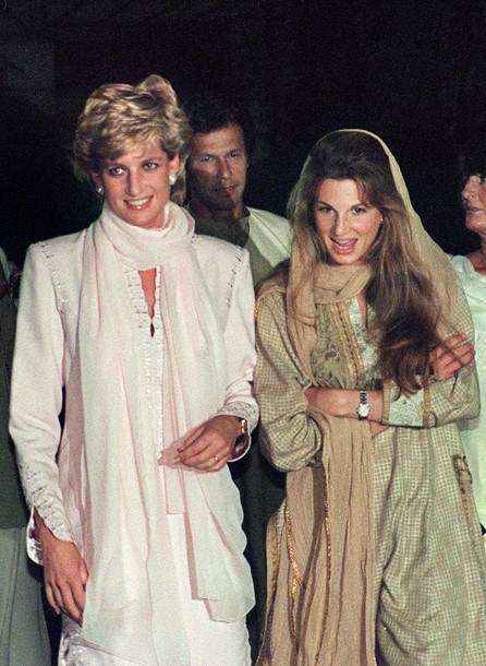 February 21, 1996: Diana, Princess of Wales (L) heads toward a restaruant for dinner with Jemima Khan (R), the British wife of former Pakistani cricketer Imran Khan in the background) in Lahore, Pakistan. Diana, Princess of Wales is on a private visit to participate in the fund raising campaign for Khan's cancer hospital.