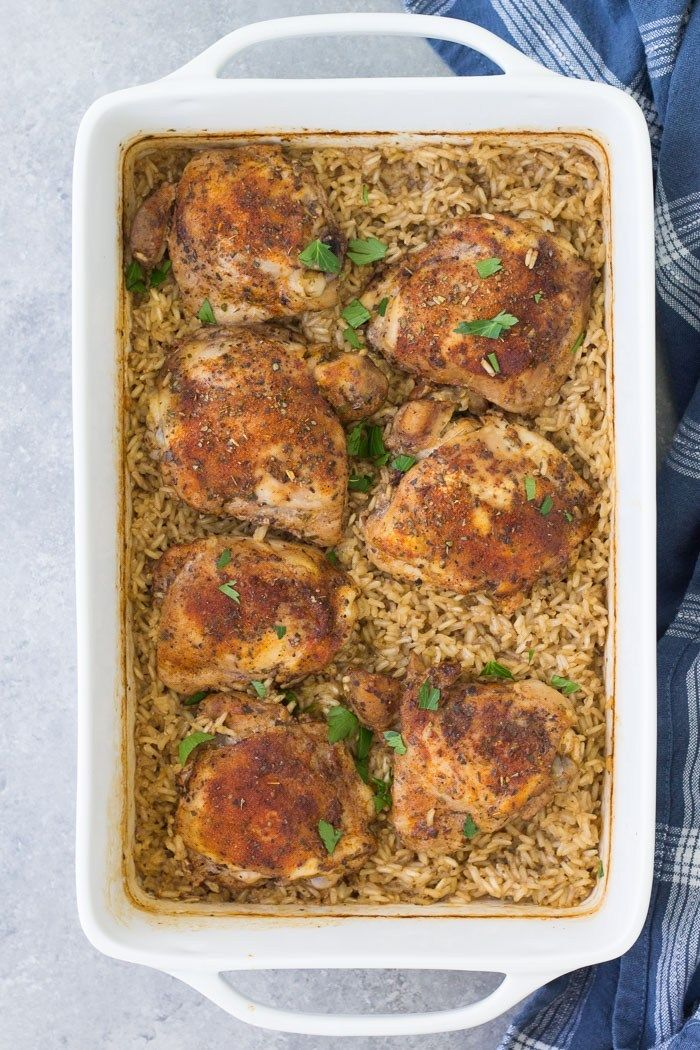 In This Easy Baked Chicken And Rice Casserole Tender Chicken Thighs And Rice Cook Toget Easy Rice Recipes Boneless Chicken Thigh Recipes Easy Chicken And Rice