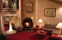 The giant champagne glass on the left is the bathtub! -Poconos Rooms and Lodging | Pocono Mountains Accommodations