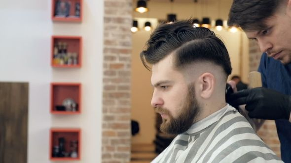 Men's Hairdressers Barbers. Barber Cuts the Client Machine for Haircuts. Background Salon Barbershop