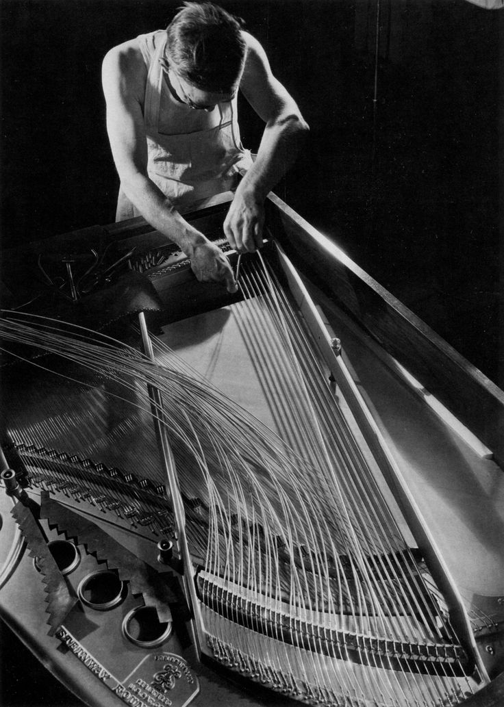 Margaret Bourke-White, Steinway factory worker stringing a grand piano, 1934
