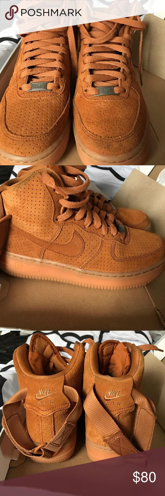 Women's Air Force 1 Hitop Suede Authentic Dark Camel Hightop Air Force 1 tennis shoe. There is a small dark mark on the front that is shown in the picture. This can be cleaned if you have some suede shoe cleaner. Nike Shoes Sneakers