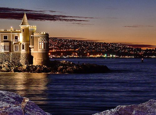 That Castle is actually in Viña del Mar with the part in the background being Valparaiso, Chile. That view is about 10 minute walk from where I live.