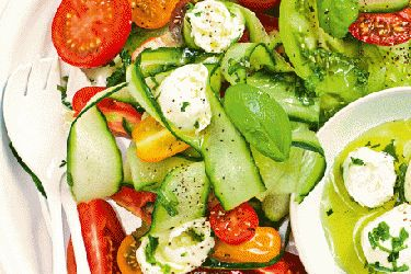 Mixed tomato salad with mozzarella and basil dressing