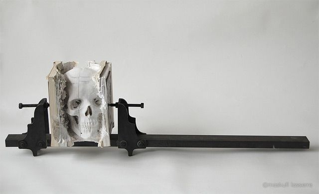 new work-in-progress by one of my favorite artists Maskull Lasserre (previously). Incarnate (Three Degrees of Certainty II) is nearly perfect rendering of a human skull from a thick stack of outdated computer manuals.