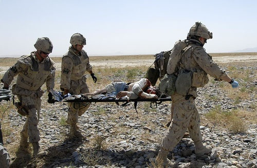 carrying a wounded Afghan man