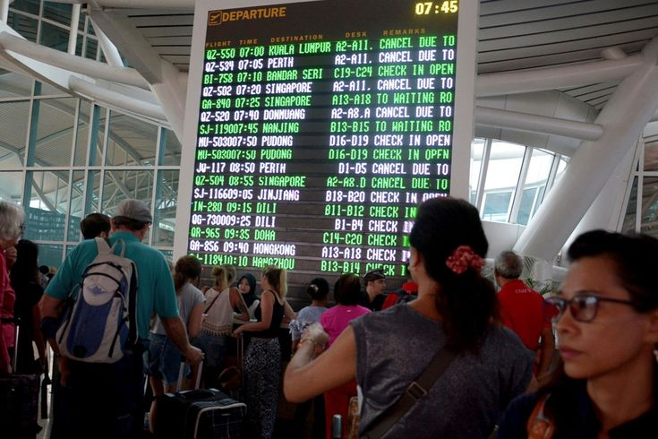 Australian Tourists in Bali Stranded by Volcanic Smoke Seek Help  On Monday Nov. 27 2017 a flight information board shows canceled flights due to smoke from Mount Agung at the Ngurah Rai International Airport in Bali Indonesia. Ketut Nataan / Associated Press  Skift Take: As volcano Mount Agung continues to spew ash into the atmosphere and winds change direction regularly the situation remains a fluid one for stranded travelers. But the long-term impact on Balinese tourism will probably be…
