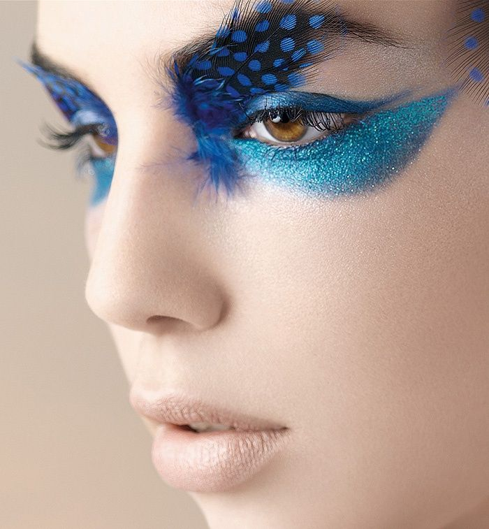 Eye make up with feathers for a gorgeous finish effect-Halloween or dress up party!