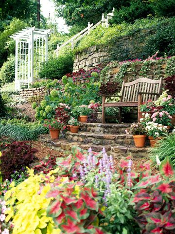 Garden up a slope -- from http://www.bhg.com/gardening/landscaping-projects/landscape-basics/slope-solutions/#page=4