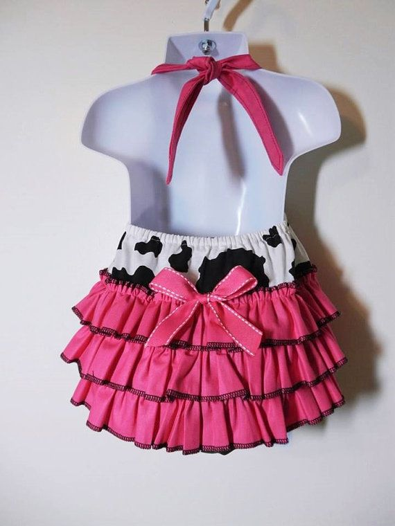 This size 18-24 month brightly colored cowgirl romper has three rows of ruffles…