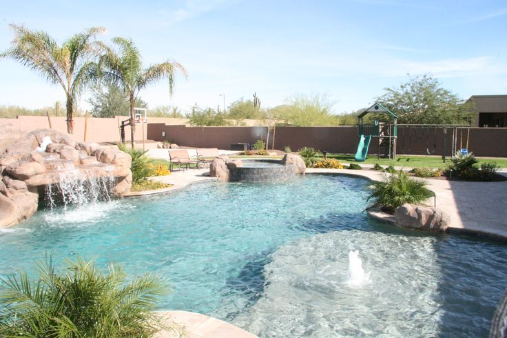 Freeform, Lagoon-style pool in Scottsdale, AZ by Unique Landscapes & Custom Pools - this project sports a huge pool, spa, and rock waterfall & grotto with an amazing baja step.