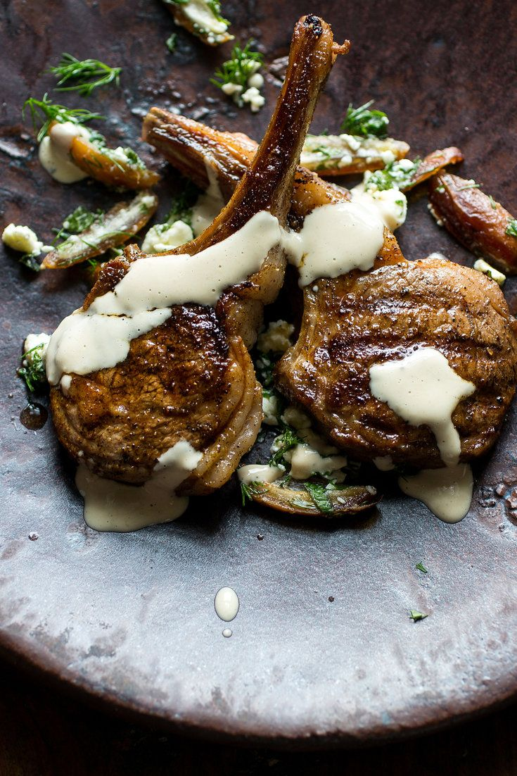 These tender little lamb rib chops have a deep, complex flavor thanks to a marinade imbued with cumin and Aleppo pepper After a brief soak, they get quickly seared, then served with a garlicky tahini-yogurt sauce and a tangy herb salad filled with feta cheese and sweet dates It's a festive, colorful, company-worthy main course that comes together fast.