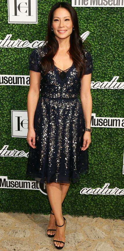 Who says sparkle is only for nighttime? Lucy Liu dazzled at the Couture Council Award luncheon in a navy Carolina Herrera embellished dress. #InStyle
