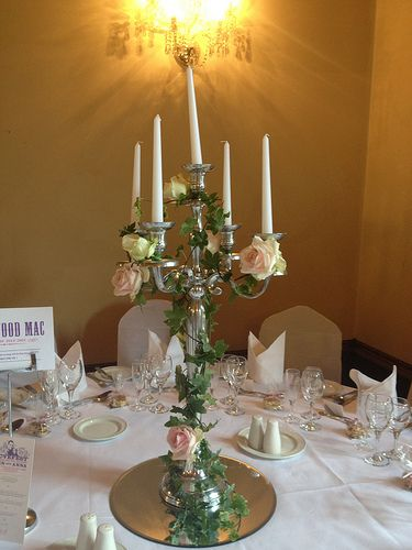 Country Garden Wedding theme with candelabras decorated with roses