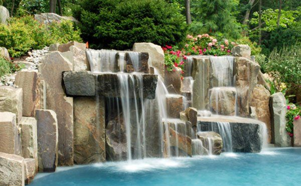 15 Pool Waterfalls Ideas for Your Outdoor Space