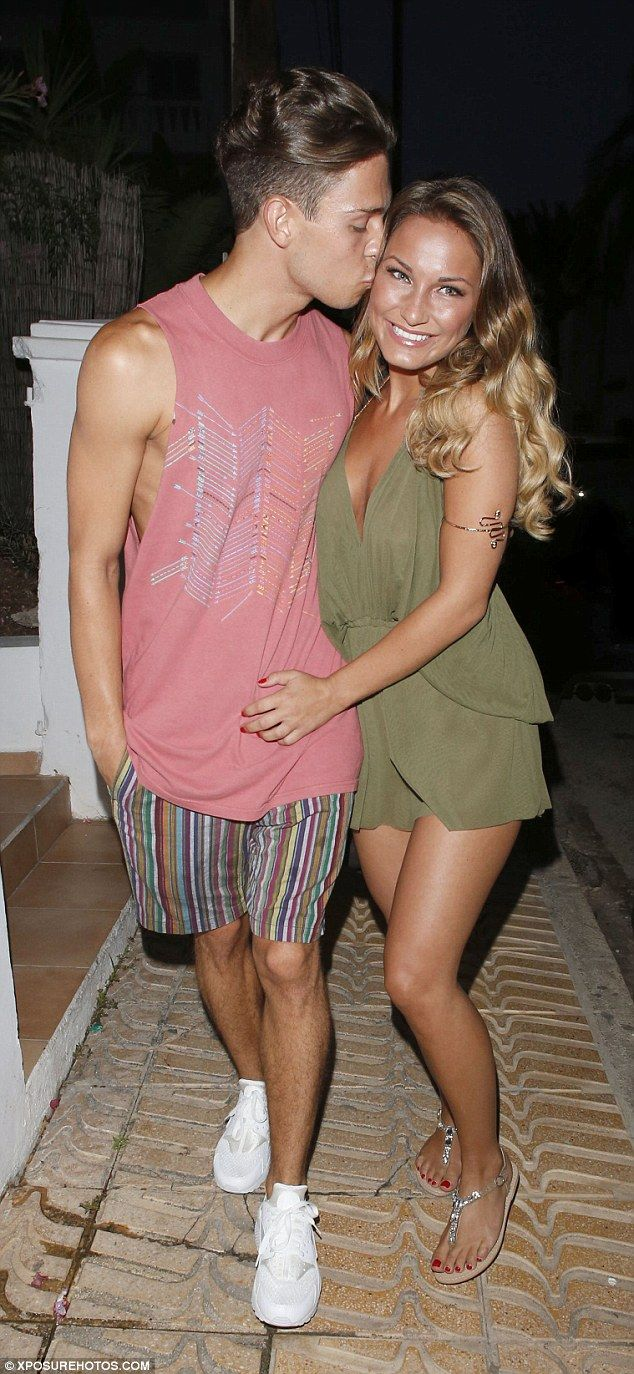 Affectionate: Joey Essex gave his girlfriend Sam Faiers a big kiss as they stepped out to celebrate pal Ferne McCann's birthday with her boyfriend Charlie Sims in Ibiza