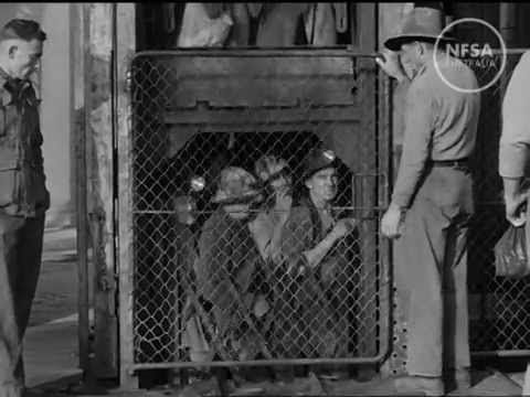▶ Goldtown - Made by The National Film Board 1948. Directed by R Maslyn Williams. Much of the romance associated with the development of the gold industry is to be found at Kalgoorlie on the golden mile, that rich strip of Western Australian territory. This film illustrates life in the town and the work of the miners: the school of mining, the vast store of mining tradition, the old-time prospectors who still search the surrounding countryside for new and fabulous strikes.