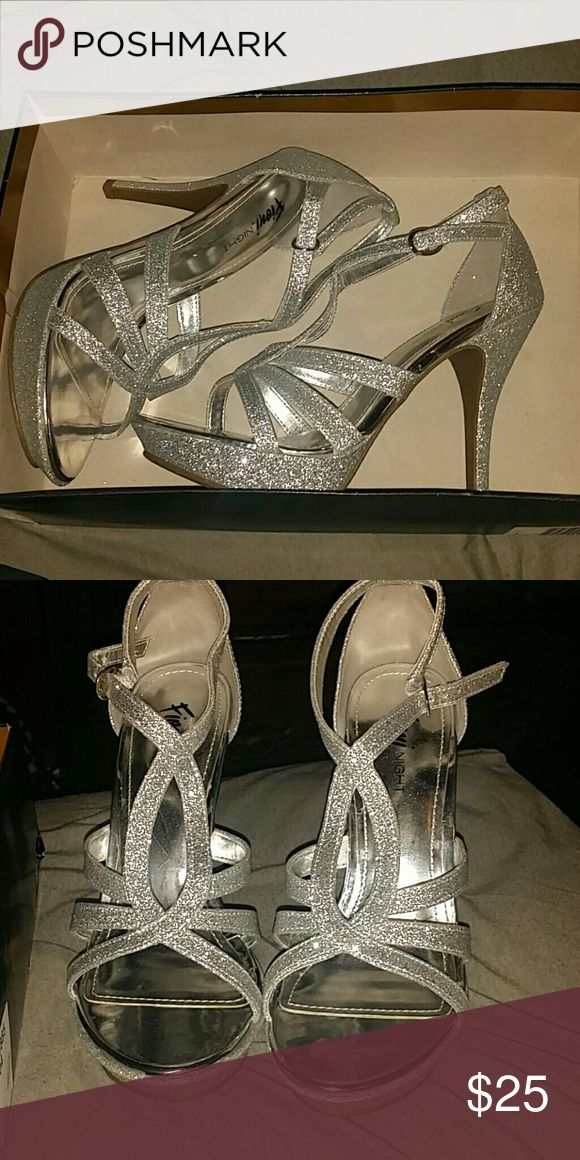 Don't need anymore Silver, sparkly prom shoes, never worn, heels are about 4 inches tall, very comfortable. FIONI Clothing Shoes Heels