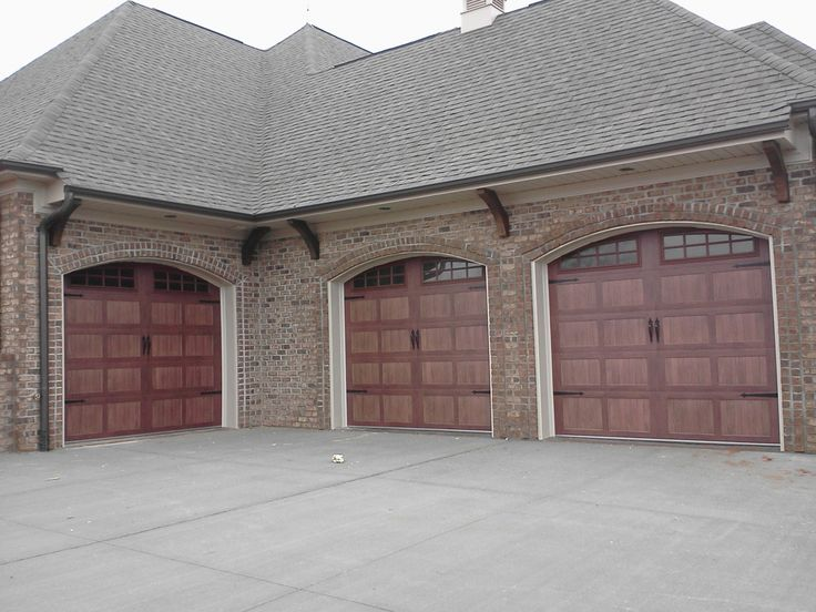 @C.H.I. Overhead Doors model 5283 Steel Carriage House Style Garage Doors in Accents Dark Oak with Arch Stockton Glass & Flat Black Spade Decorative Hardware