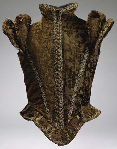 Spanish jerkin from brown silk velvet, bordered by metal trim, c. 1580, Metropolitan art museum, New York.