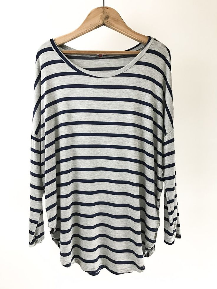 Striped Slouchy Top. Slouchy for the win! This casual and cute Striped Slouchy Top features a dolman sleeve, wide neck, and round hem. Perfect for achieving that effortless looked. Casual  outfit. therollinj.com