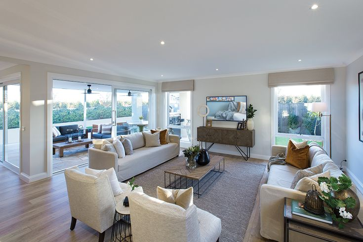 Family room in the Forsyth display home with a Tuscany World of Style.